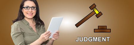 Woman using digital tablet with judgment concept on background