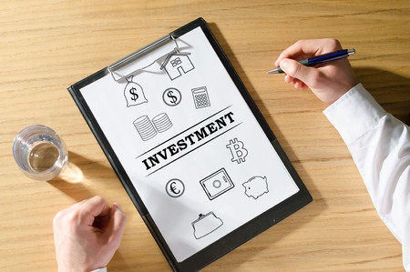 Investment concept on a clipboard Stock Photo