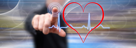 Man touching a heart beats graph on a touch screen with his finger Banco de Imagens - 116978523