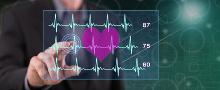 Man touching a heart beats graph concept on a touch screen with his finger Banco de Imagens - 117663128