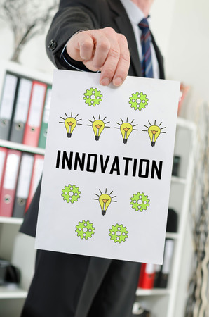Paper showing innovation concept held by a businessman Reklamní fotografie