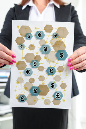 Paper with currency network concept held by a businesswoman