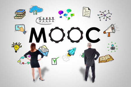 Mooc concept drawn on a wall watched by business people