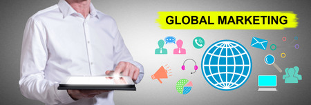 Man using a tablet with global marketing concept