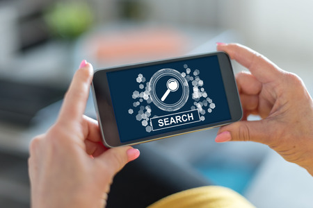 Smartphone screen displaying a search concept Stock Photo