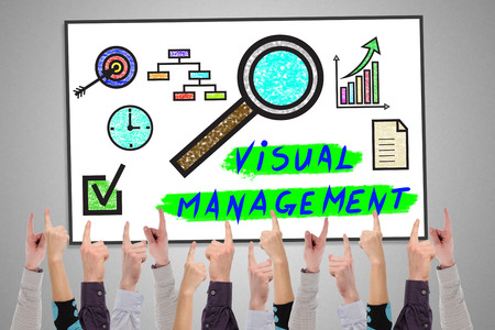 Visual management concept on a whiteboard pointed by several fingers