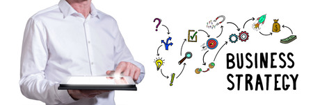 Man using a tablet with business strategy concept