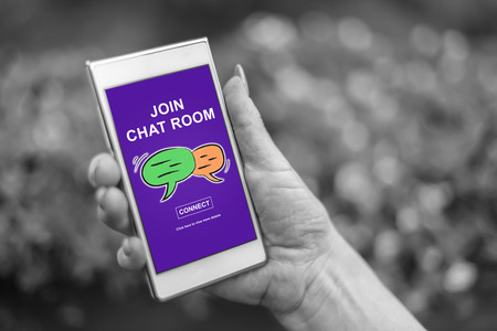 Female hand holding a smartphone with chat room concept