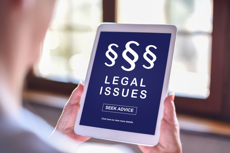 Tablet screen displaying a legal issues concept Stock Photo