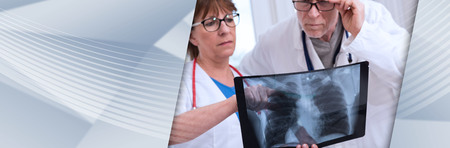 Two doctors examining x-ray report in medical office. panoramic banner