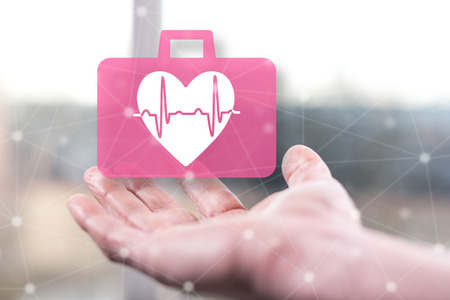 Cardiac emergency concept above a hand of a man