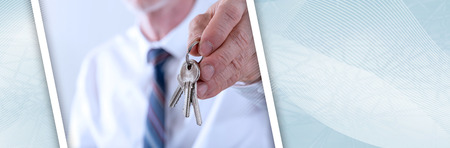Real estate agent giving house keys. panoramic banner