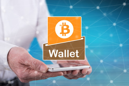 Bitcoin wallet concept above a smartphone held by hands