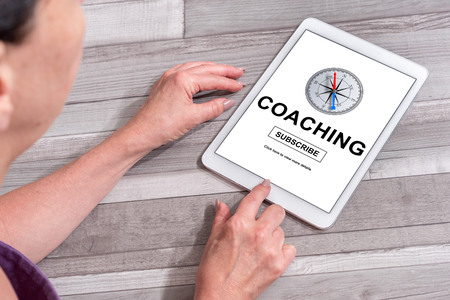 Woman using a tablet showing coaching concept