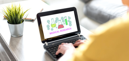 Laptop screen displaying a medical research concept Banco de Imagens