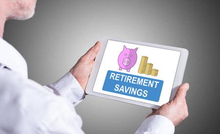 Man holding a tablet showing retirement savings concept Reklamní fotografie