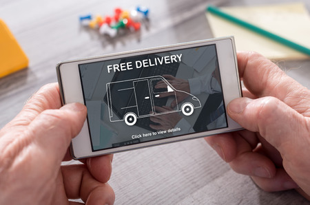 Free delivery concept on mobile phone