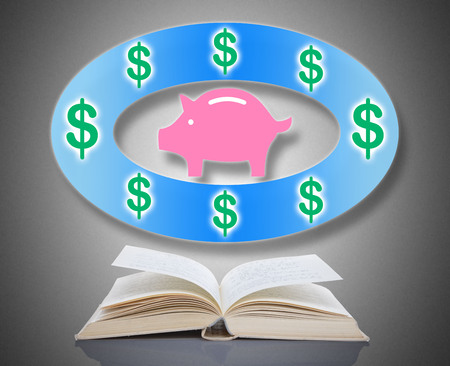 Saving money concept above an open book Stock Photo