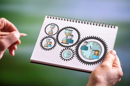 Hand drawing time management concept on a notepad