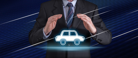 Car insurance concept with businessman in a protective gesture