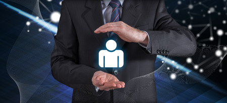 Liability insurance concept with businessman in a protective gesture