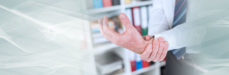 Businessman suffering from wrist pain at office. panoramic banner