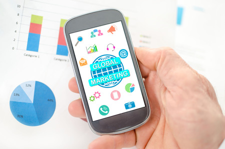 Global marketing concept on a smartphone held by a hand