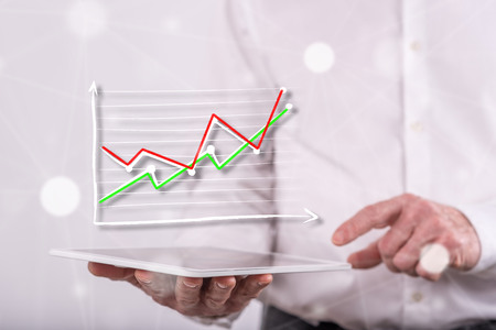 Business analysis concept above a tablet held by a man in background