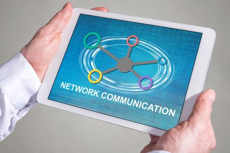 Tablet screen displaying a network communication concept Reklamní fotografie