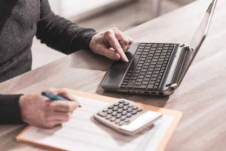 Male accountant working on laptop Stock Photo