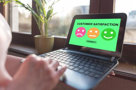 Laptop screen displaying a customer satisfaction concept