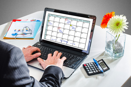 Man typing on a laptop showing a planner concept