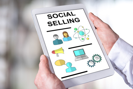 Man holding a tablet showing social selling concept