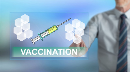Man touching a vaccination concept on a touch screen with his finger