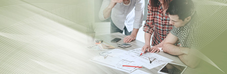 Architects working on plans at office, light effect. panoramic banner