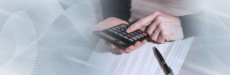 Male hand using calculator, accounting concept. panoramic banner