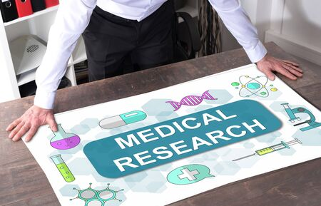 Man watching a medical research concept placed on a desk