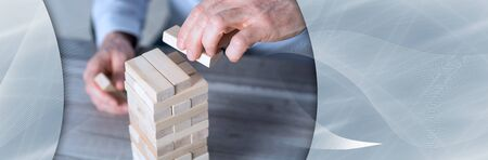 Business development concept by building a tower with domino blocks. panoramic banner