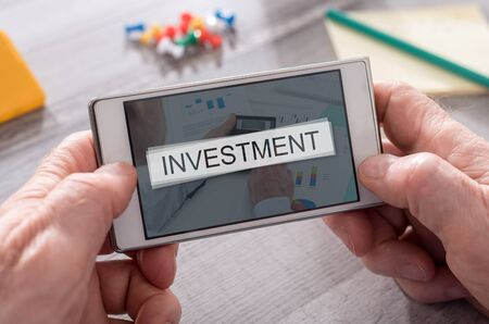 Investment concept on mobile phone Stock Photo