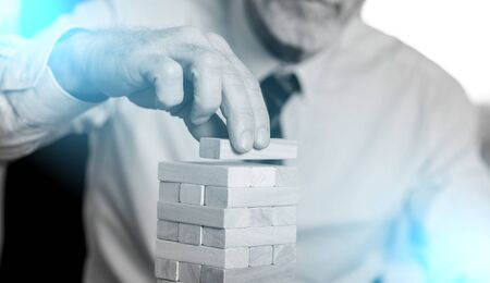 Business development concept by building a tower with domino blocks