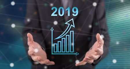 Business growth in 2019 concept above the hands of a man in background