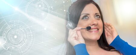 Smiling pretty woman using an headset; multiple exposure Stock Photo