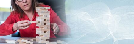 Concept of business risk with domino blocks; panoramic banner Stockfoto