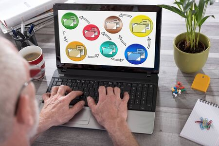 Data transfer concept shown on a laptop used by a man Stok Fotoğraf