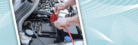 Hands of car mechanic using cables to start a car engine. panoramic banner Reklamní fotografie - 124824366