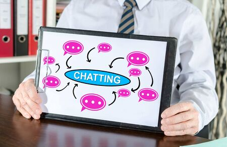 Chatting concept shown by a businessman Stockfoto