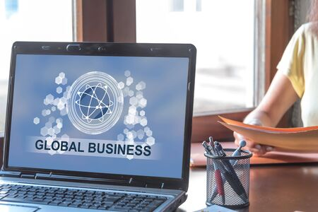 Laptop screen displaying a global business concept