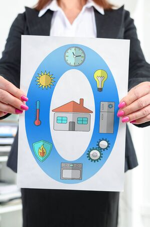Paper with smart home concept held by a businesswoman Stock fotó