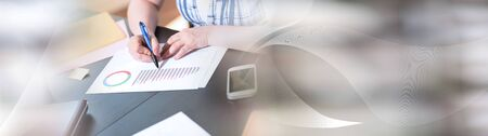 Businesswoman working on business report at office, light effect; panoramic banner