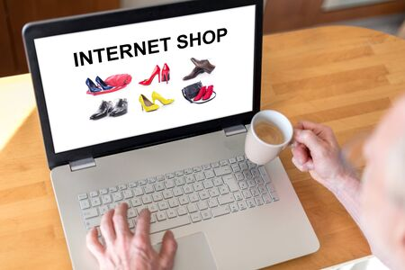 Man using a laptop with internet shop concept on the screen